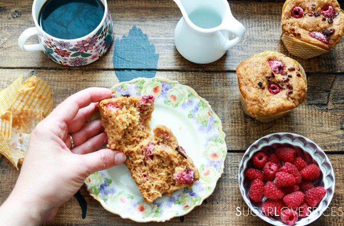 coconut raspberry spelt muffins-hand on a muffin