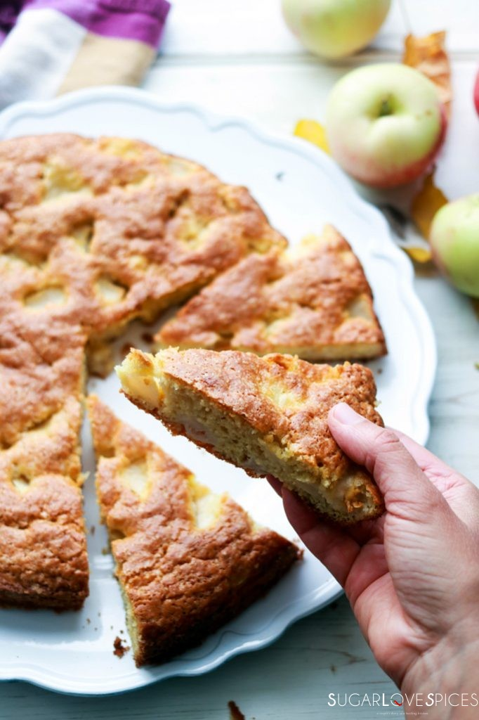 Torta di Mele (Apple Cake with Olive Oil)-slice in hand