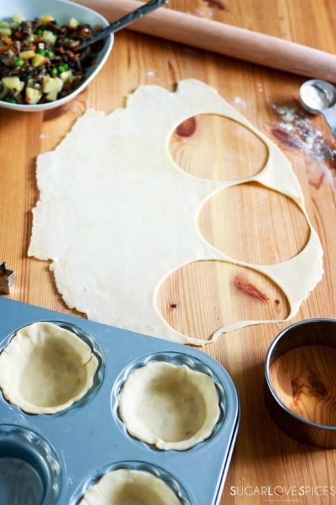 Mini Mushroom Pies with Pea and Potato-cutting the pies