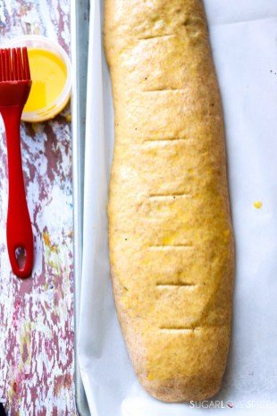 Ukranian Poppy Seed Roll-roll on a baking sheet, slits on top