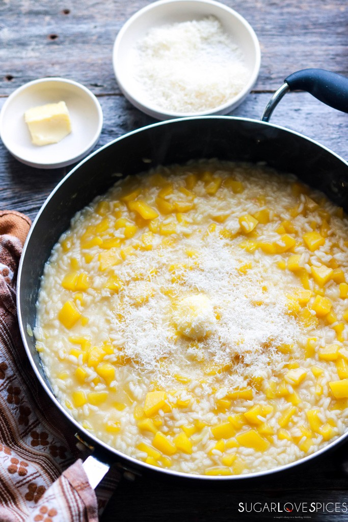 best squash risotto recipe-add butter and Parmigiano to risotto in the pan