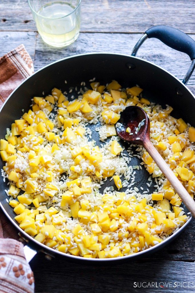 best squash risotto recipe-toast the rice with the squash in the pan