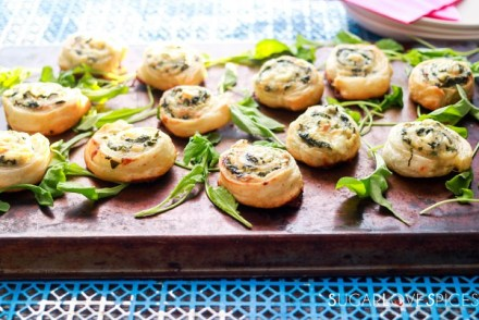 Spinach and Feta Pinwheels-on the pan with greens
