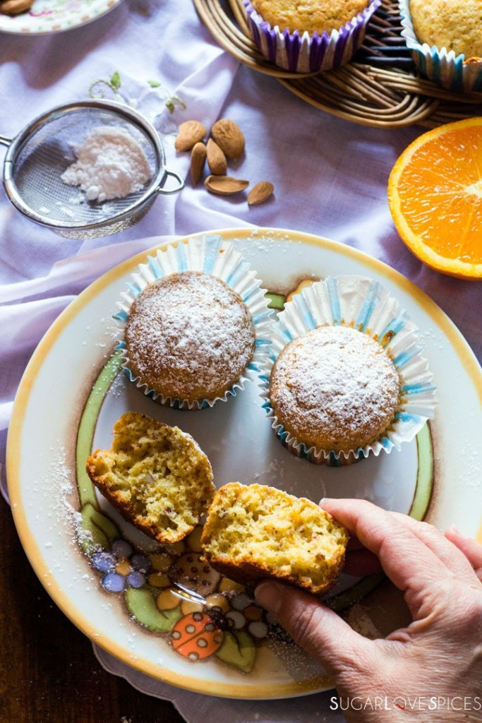 Easy Almond Orange Muffins-open muffin with hand