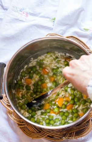 Rice with peas and carrots-stirring the pot
