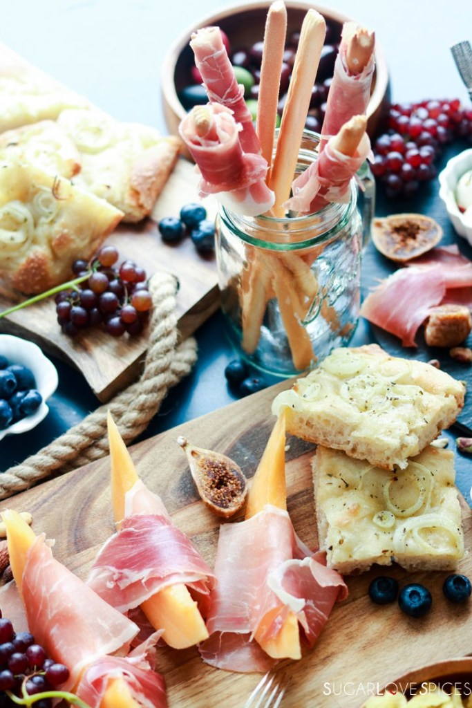 An Antipasto Story featuring Prosciutto-top view of some boards