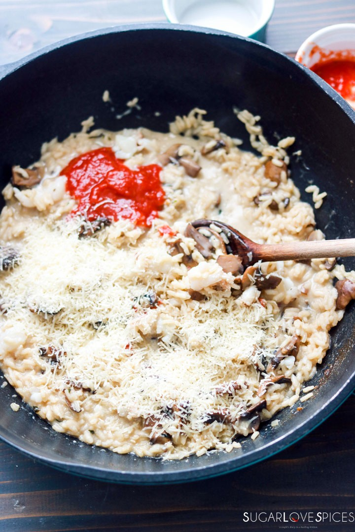 Crimini Mushroom and Lobster Risotto-stirring tomato paste in the pan