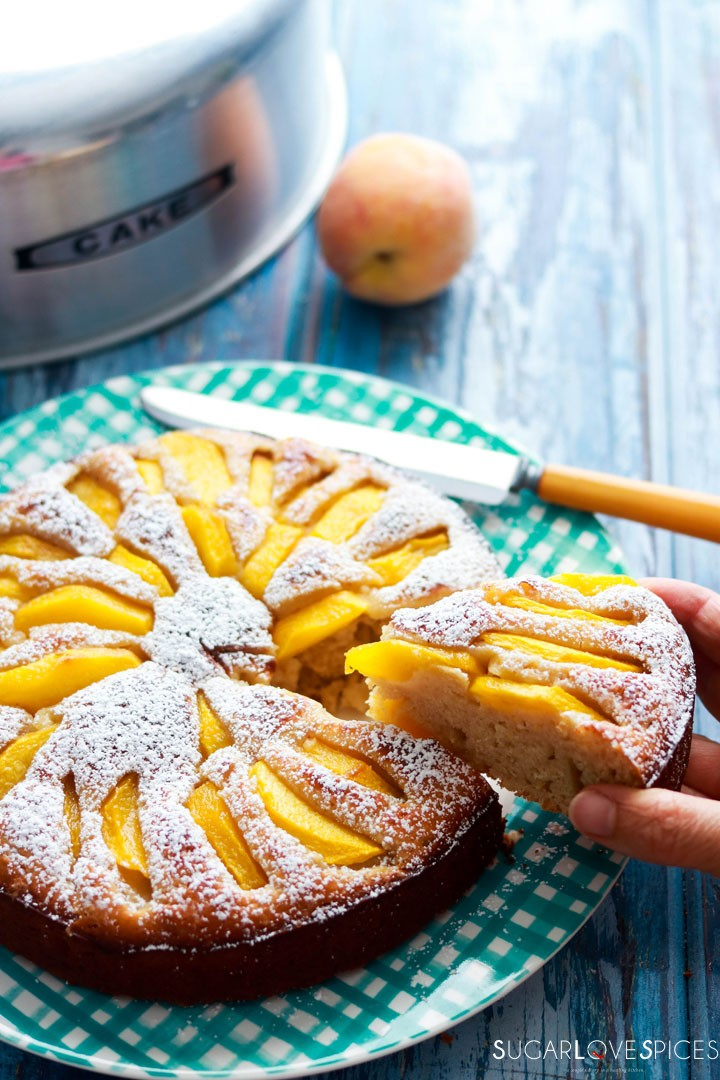 Spelt flour peach yogurt cake-slice in handl