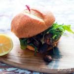 Steak sandwich-feature-on a wood board with lemon on the side