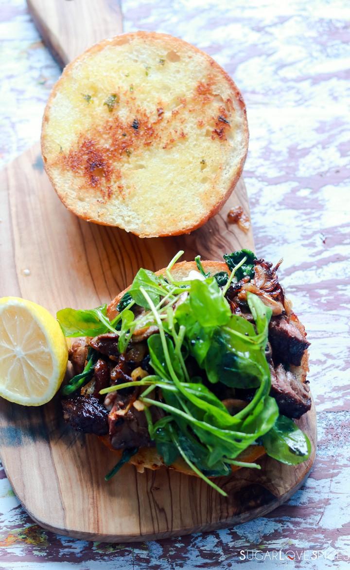 Steak sandwich-on a wood board-open
