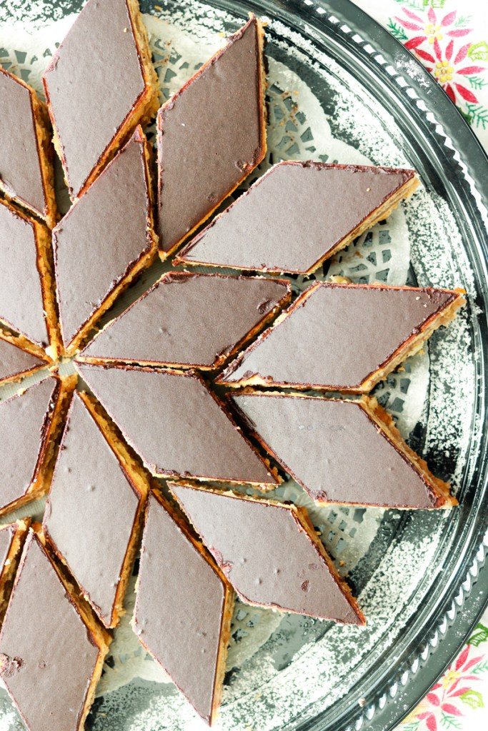 Hungarian Gerbeaud cake-partial cake on a serving plate-pinterest