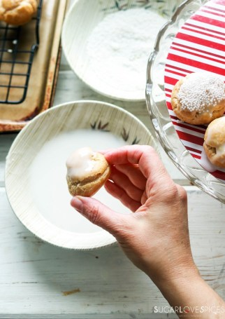 Profiterole Christmas Tree-prep-dipping tops in glaze