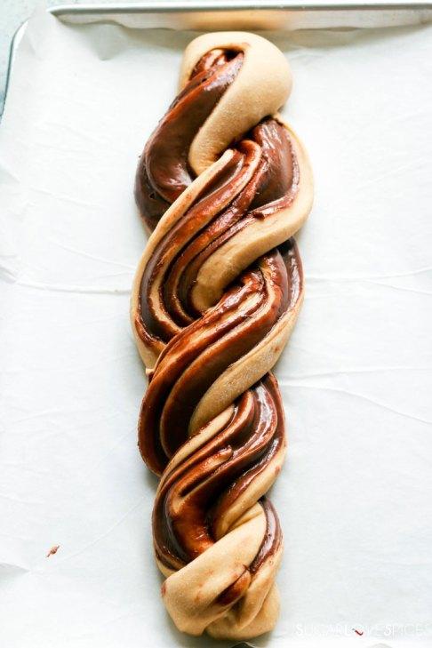 Nutella Pain Brioche braid-unbaked braid on baking sheet