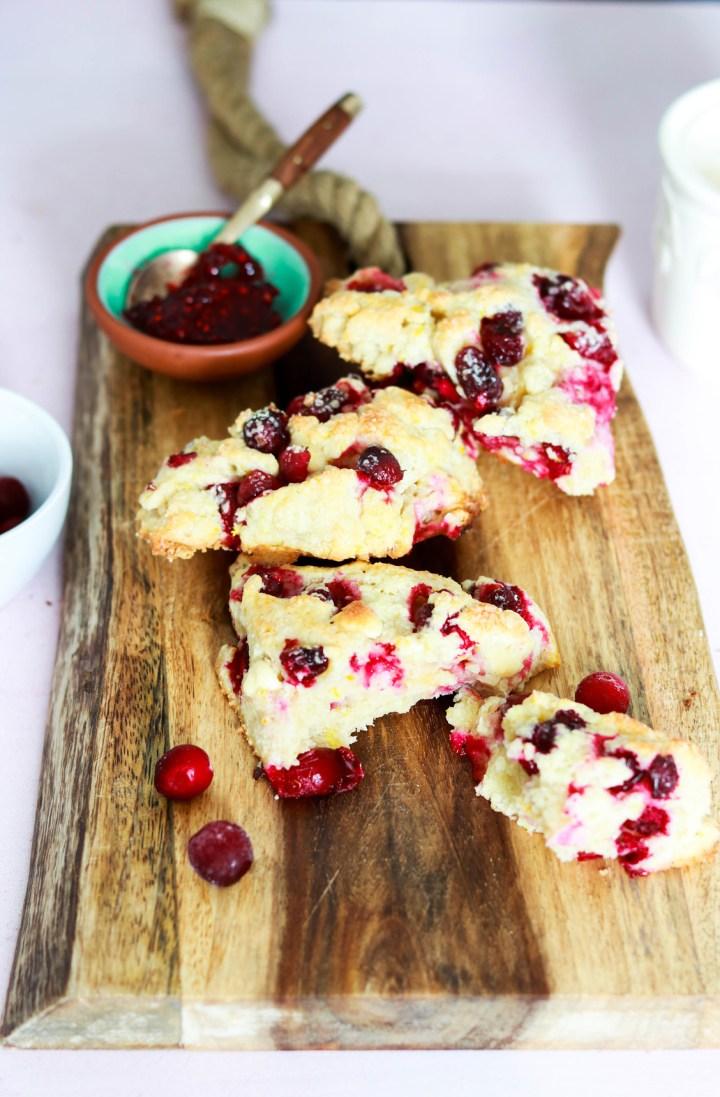 Amazing Cranberry Orange and White Chocolate Scones-scones on wood board with jam