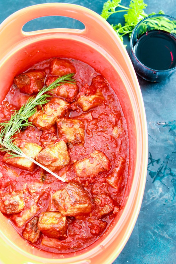 Slow-Braised-Ribs-and-Sausages-in-Sun-dried-Tomato-sauce-in-the-big-pot-red-wine-in-glass