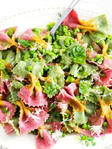 Creamy-Farfalle With Peas, Guanciale And Asiago-feature-in the platter with fork