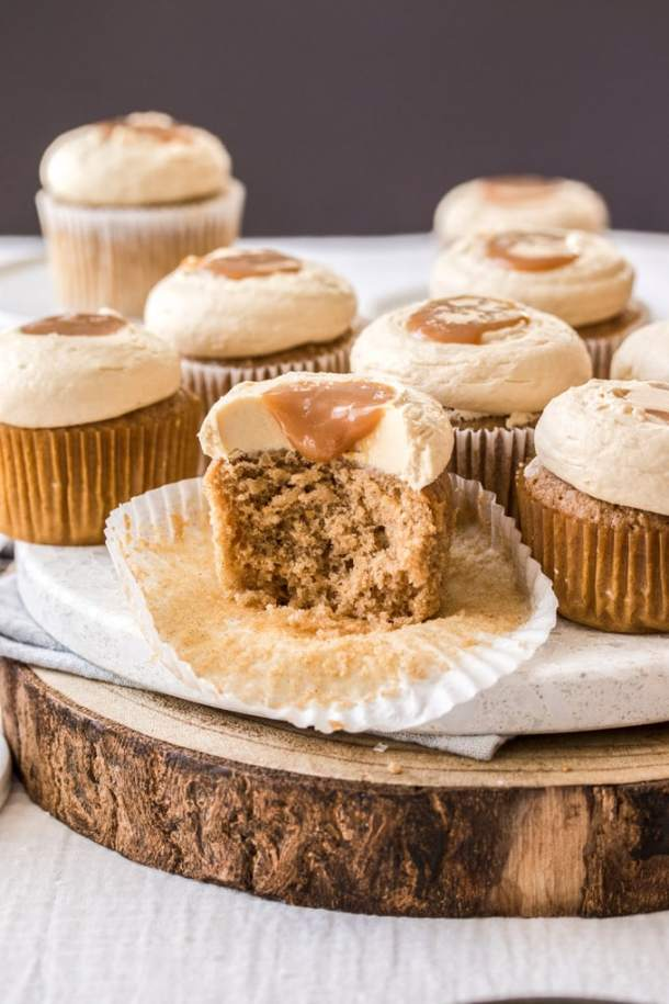 A photo with a cinnamon cupcake cut open showing the centre