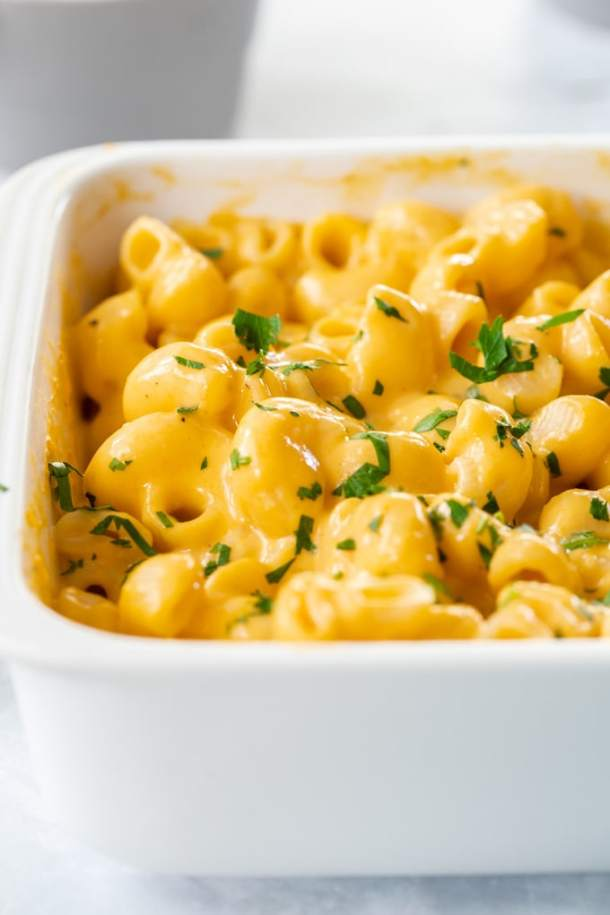 Closeup of mac and cheese in a white casserole dish