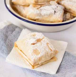 Almond Cherry Hand Pies are almond cheesecake and easy homemade cherry jam, all wrapped up in filo pastry and baked.#handpies #cherries
