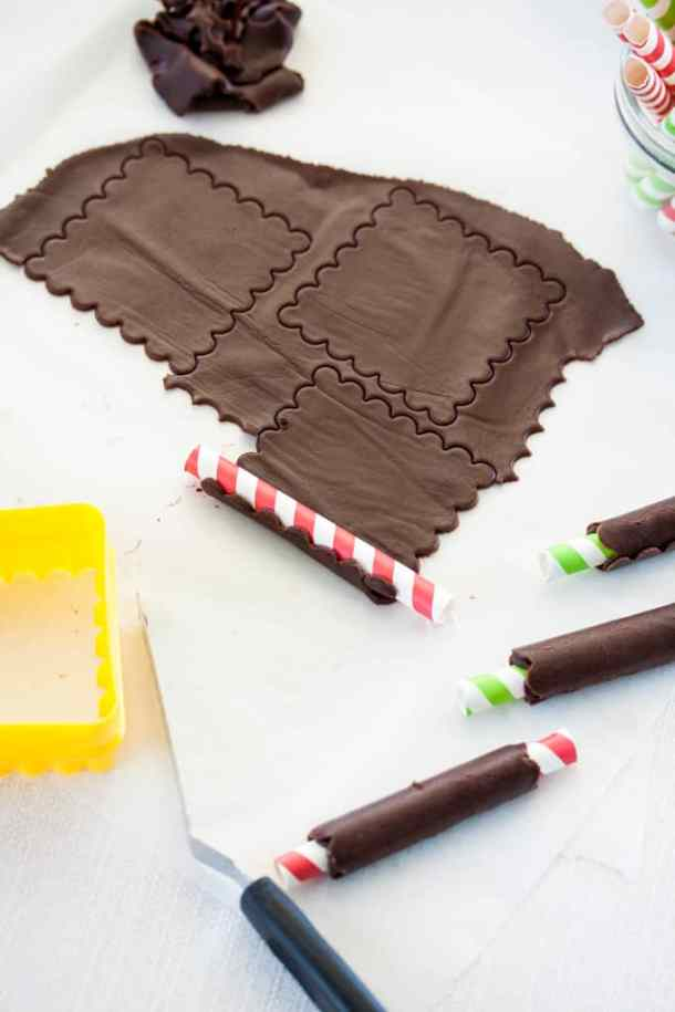 A delicious peppermint cream encased in a chocolate cookie tube make these Rolled Peppermint Chocolate Christmas Cookies the perfect new cookie to add to your Christmas baking list. #christmascookies, #peppermint #chocolate