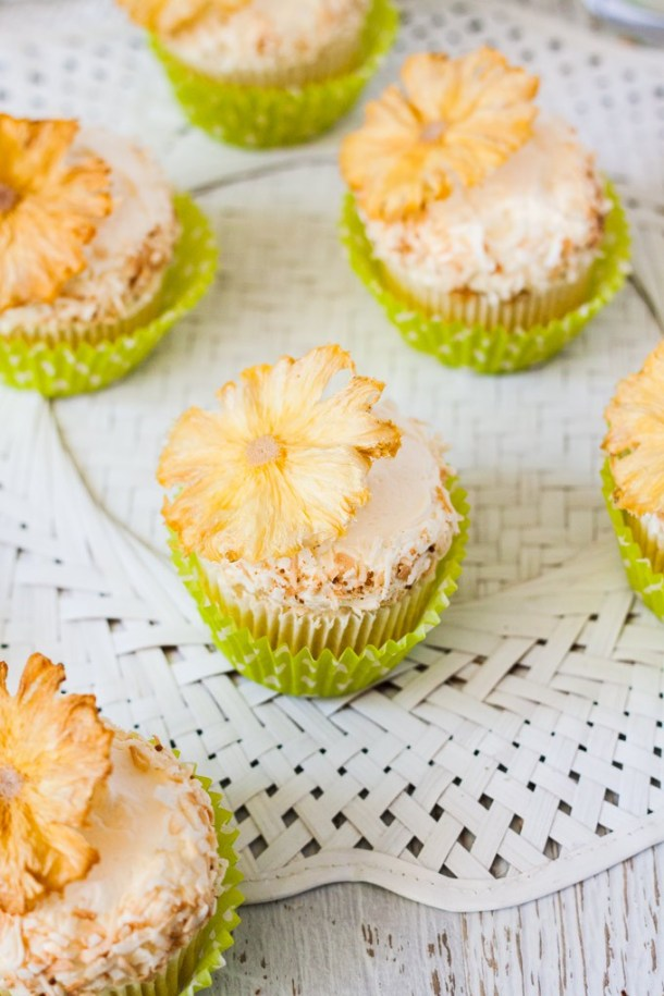 These Pineapple Coconut Cupcakes (aka Pina Colada Cupcakes) are delicious coconut cupcakes filled with homemade pineapple curd. #coconutcupcakes #pinacolada