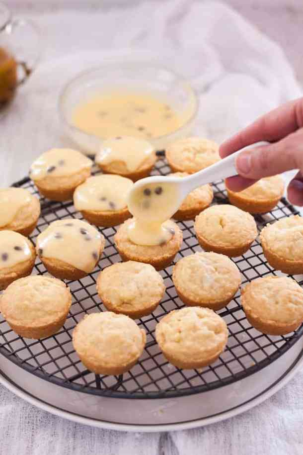Vanilla Shortbread Cookies with Passionfruit Icing - the cookies being iced