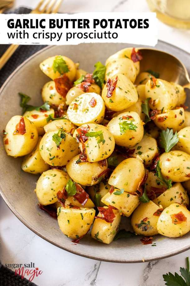 If you're after a delicious but quick and easy side dish, these perfectly cooked Buttery Garlic Potatoes topped with Crispy Prosciutto are just what you need. #sugarsaltmagic #sidedishes #sidedishrecipes #garlicpotatoes #babypotatoes #sidedish #easysidedish #thanksgivingsidedish #thanksgivingfood #potatosalad #christmassidedish #christmasrecipe #christmasfood