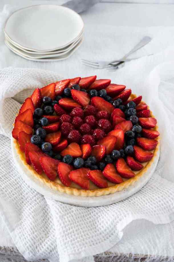 This Fruit Custard Tart recipe is light and refreshing but indulgently creamy all at once. A crisp tart shell, easy custard and fresh seasonal fruit.
