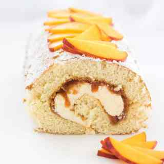 This beautiful Peaches and Cream Swiss Roll Cake Recipe is easy peach jam and the smoothest creamy frosting, all rolled up in a delicate swiss roll. If you're looking for peach desserts, this is the one you need.