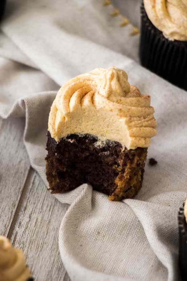 Chocolate Pumpkin Cupcakes are easy cupcakes, from scratch. Filled with chocolate, pumpkin and topped with a pumpkin spice frosting this is one of those pumpkin desserts you need in your repertoire.