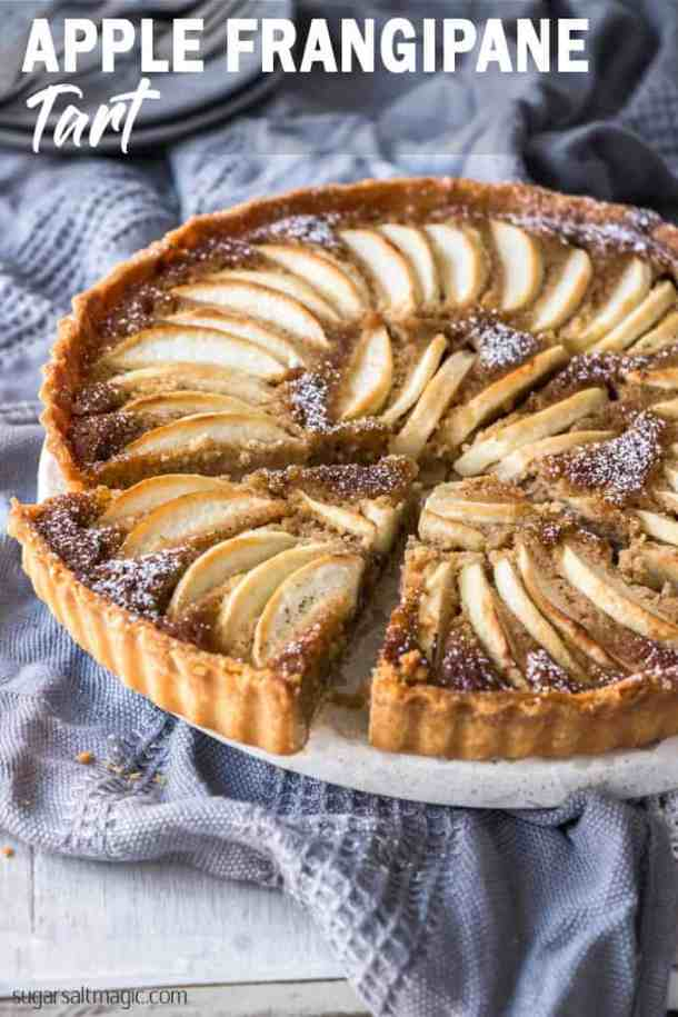 Sweet apples encased in an easy almond pastry filling and a crisp tart shell, this Apple Frangipane Tart is equal parts flavourful and delicate. If you're looking for easy apple desserts, you've found one. #sugarsaltmagic #frangipane #frangipanetart #easyappledesserts #appledesserts #fallfood #fallrecipes #falldesserts #easyfrangipanetart #applefrangipanetart