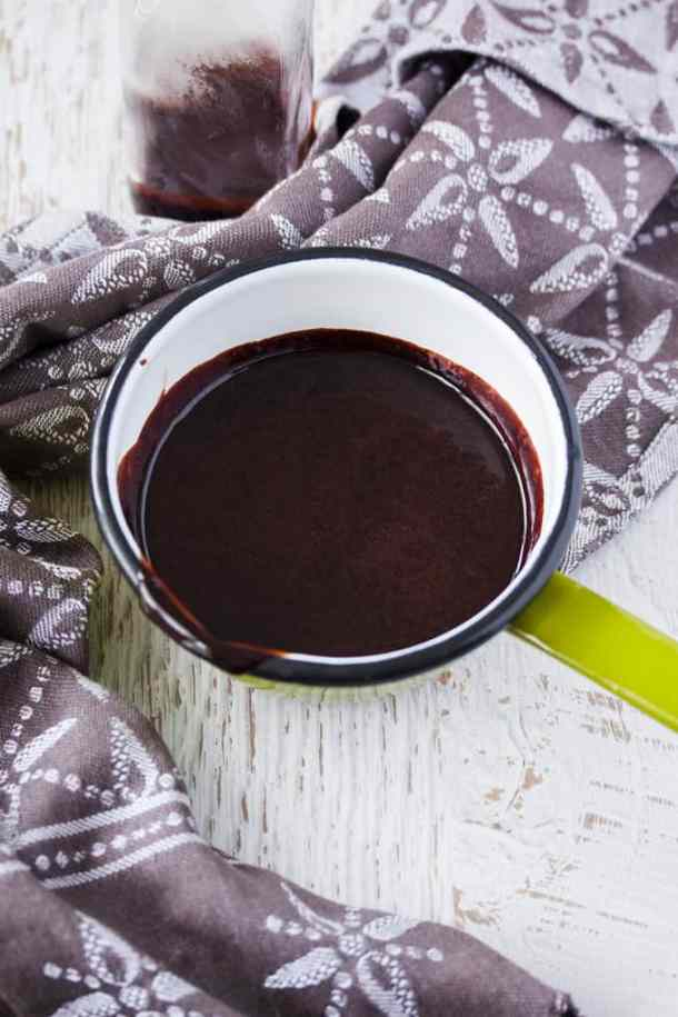 This Homemade Chocolate Sauce recipe is one I turn to most often when I want a quick and easy hot fudge sauce. A handful of ingredients and a few minutes and you'll have a thick chocolate sauce for ice cream, cakes, pancakes or any indulgent desserts.