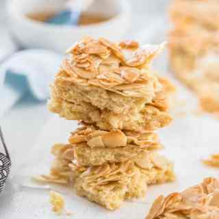 This Honey Almond Slice is an easy shortbread base topped with flaked almonds that have been mixed with a honey butter mixture. It bakes up crispy and chewy and will leave you wanting more.