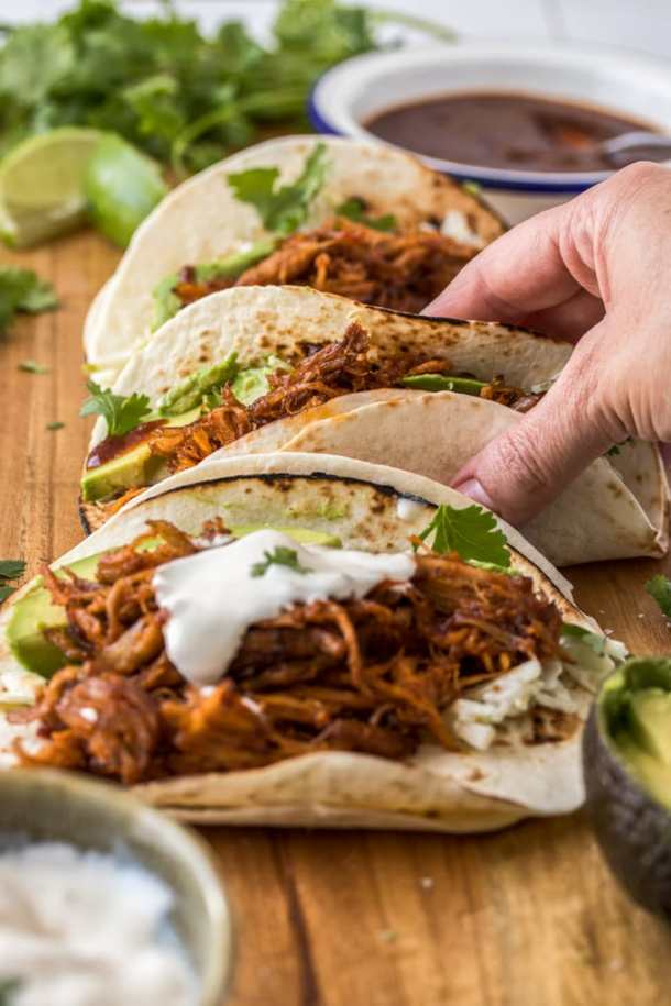 A tray of 3 pulled pork tacos