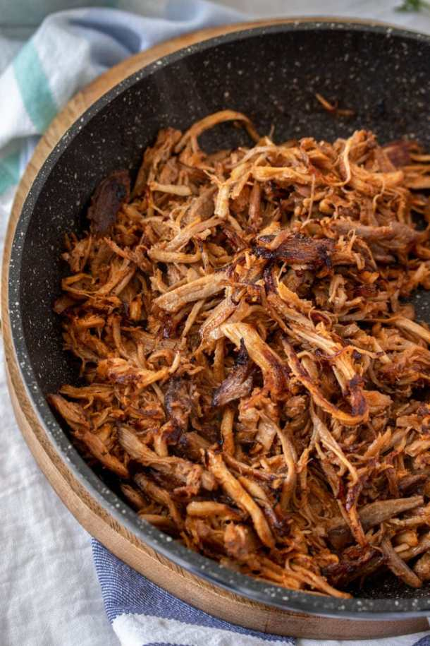 A birdseye view of a frying pan filled with BBQ pulled pork