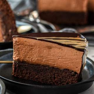 A closeup of chocolate mousse mud cake with the rest in the background