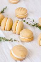 5 Lemon Melting Moments cookies surrounded by thyme
