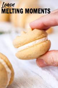 Closeup of a single melting moments cookie being held