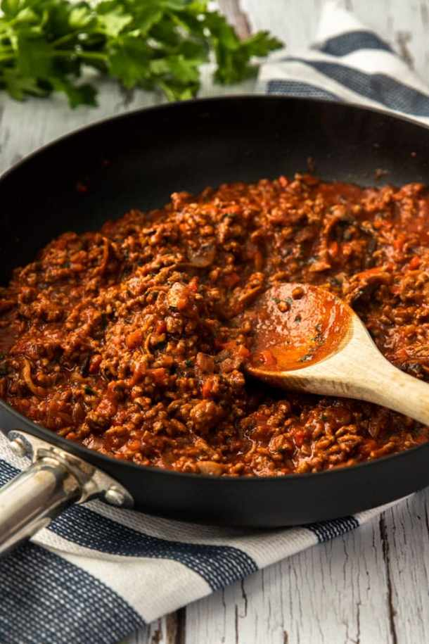 A pan of red meat sauce for pastitsio