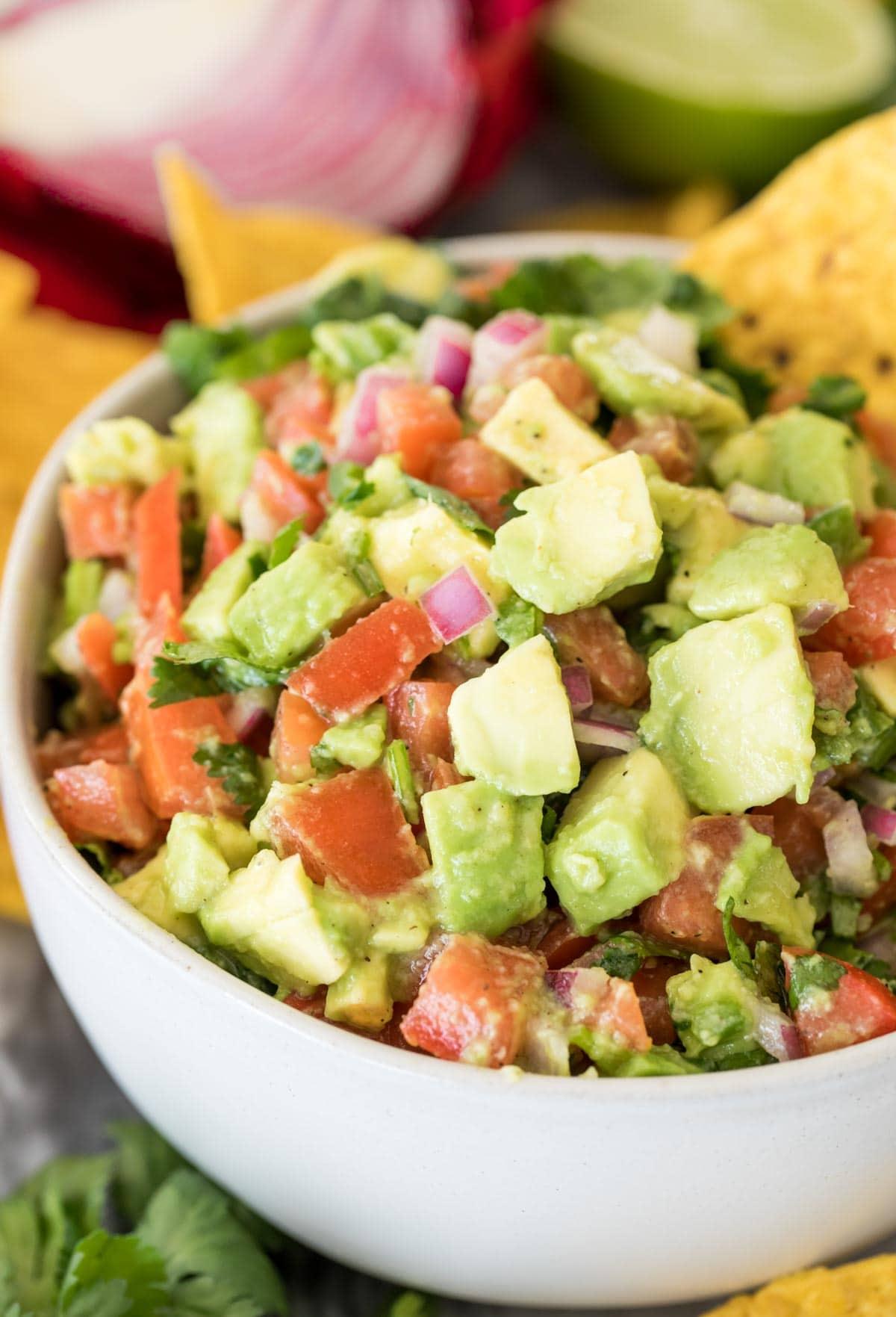 avocado salsa in white bowl