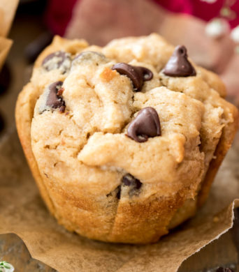 peanut butter muffin with chocolate chips on parchment paper