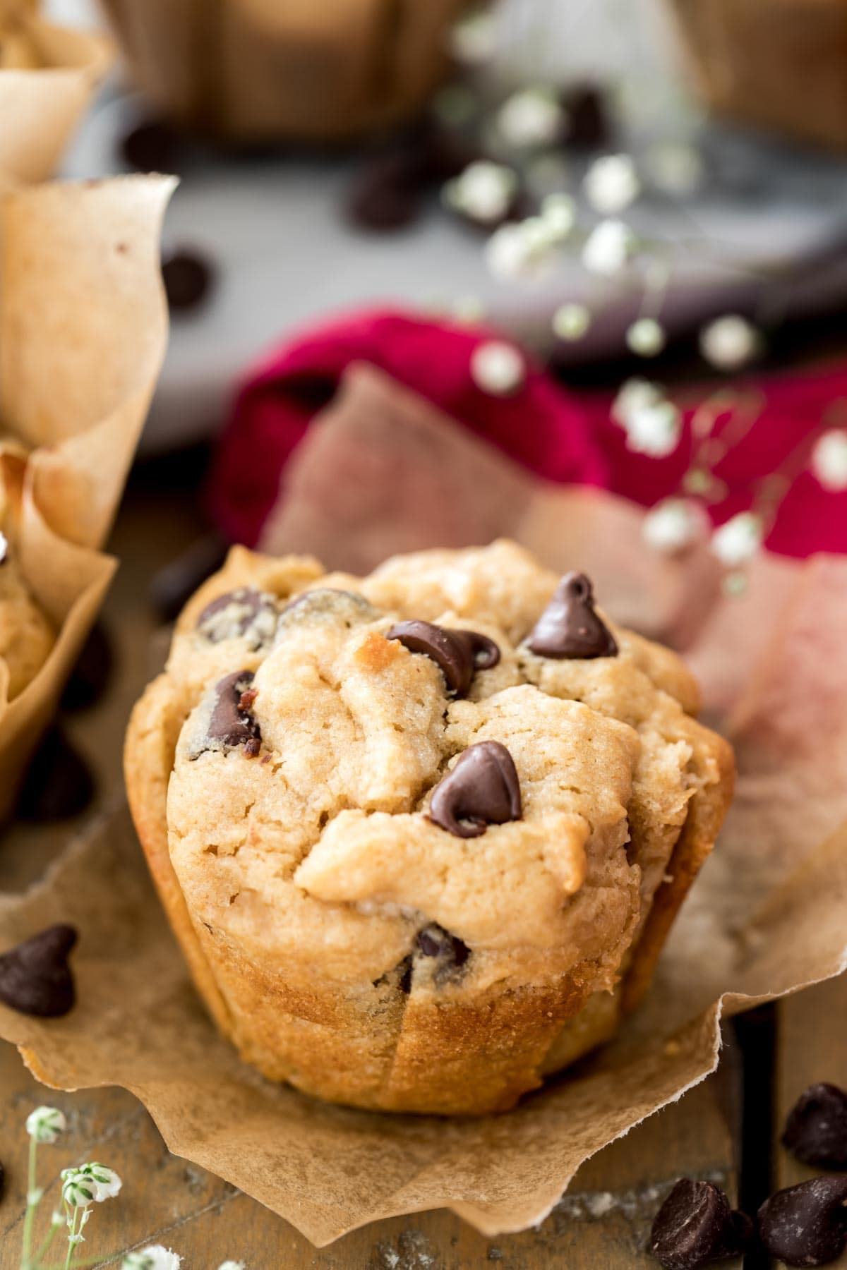 peanut butter muffin with chocolate chips on brown parchment paper