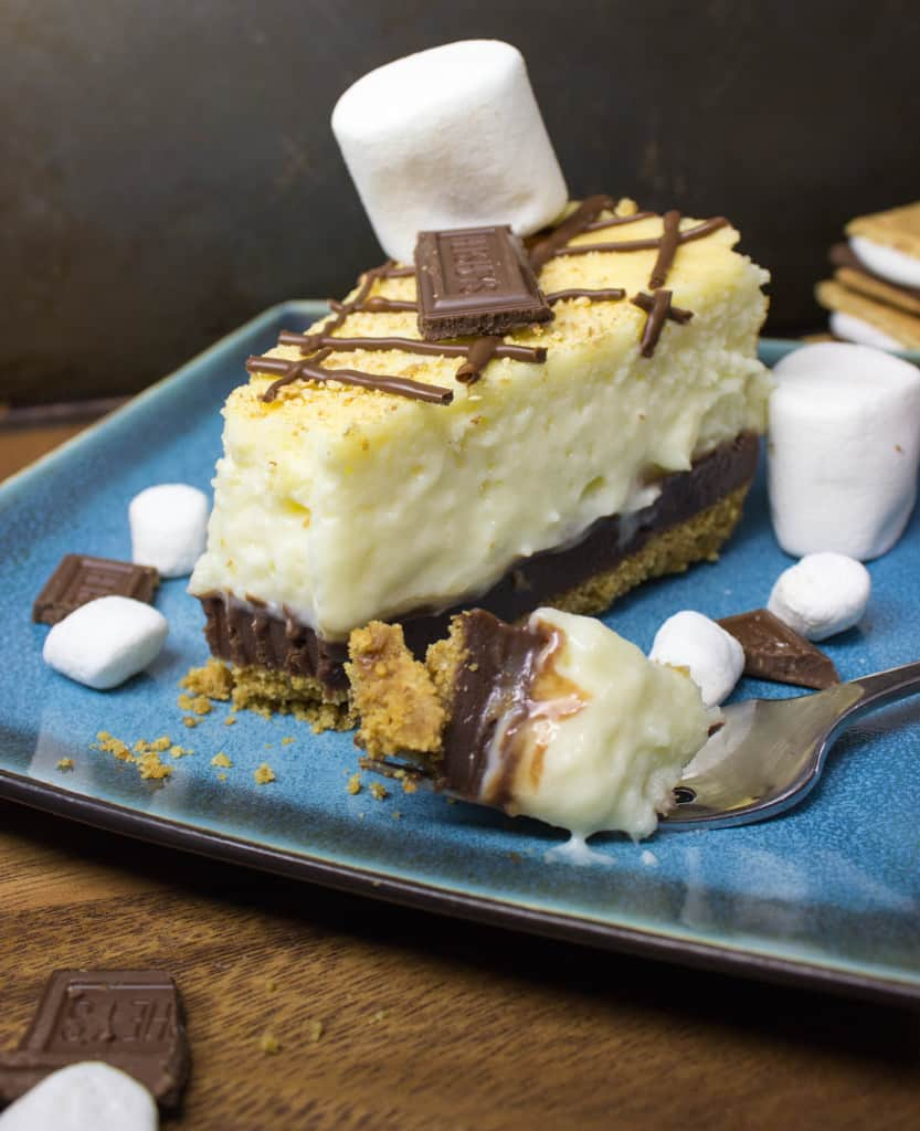 Slice of s'mores Cheesecake with fork