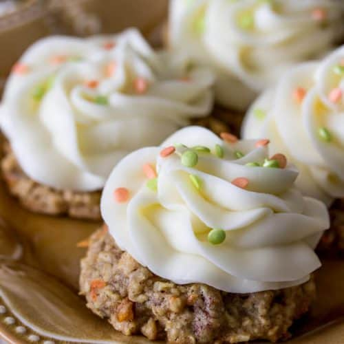 carrot cake cookies with icing and sprinkles