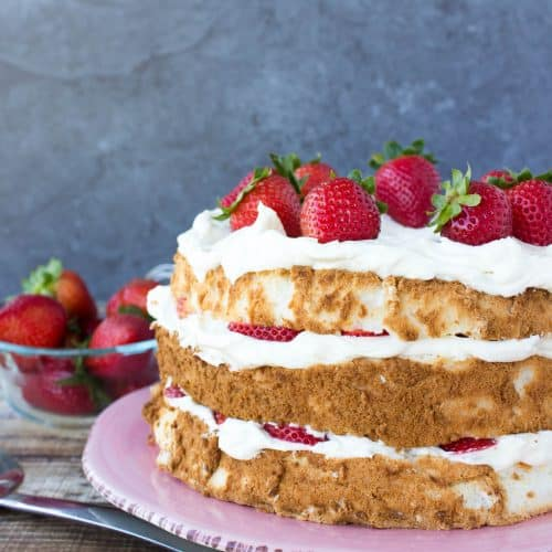 layered cake with strawberries on top and filling