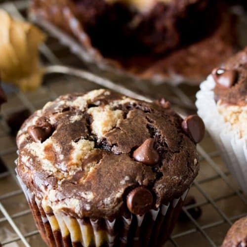 Peanut butter chocolate muffins on a cooling rack