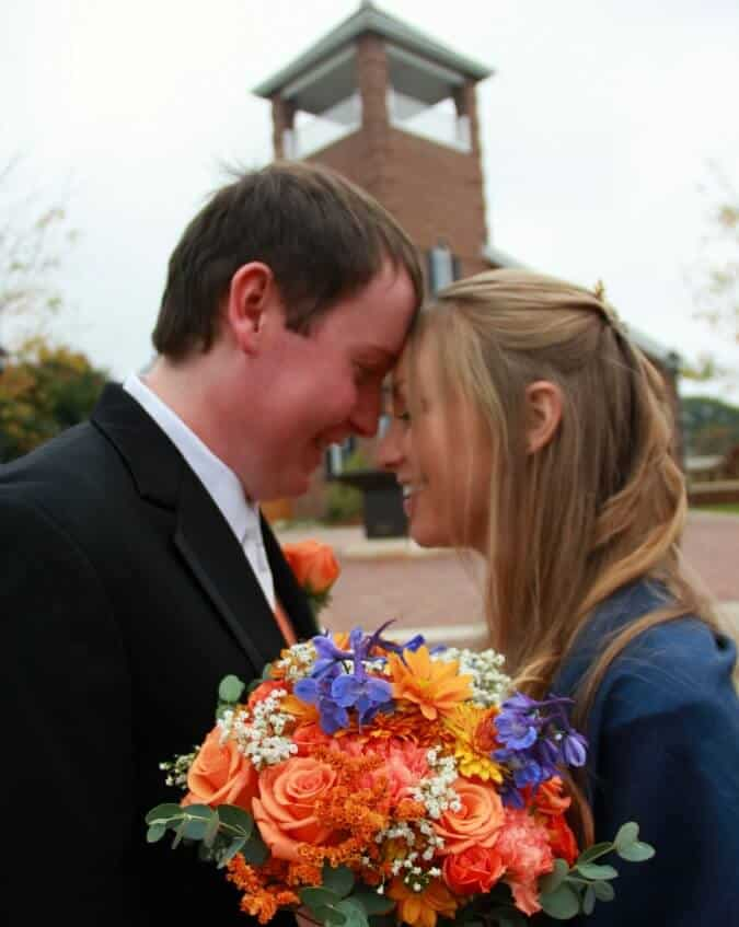 newlyweds in front of church