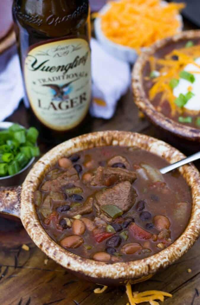 Beer Steak Chili in brown crock, Yuengling beer in background
