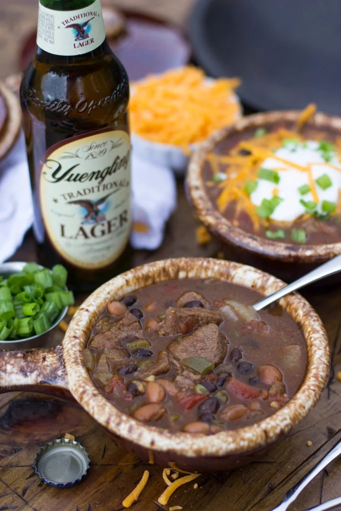 Beer Steak Chili in crock with spoon, Yuengling beer in background