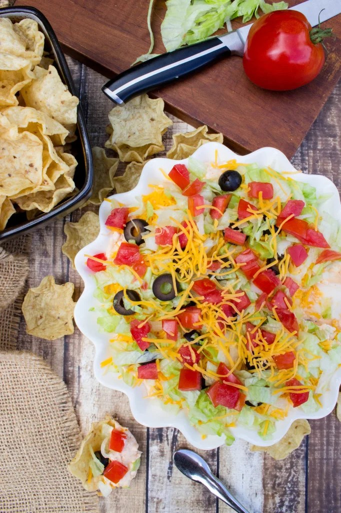 overhead of taco dip in white serving dish